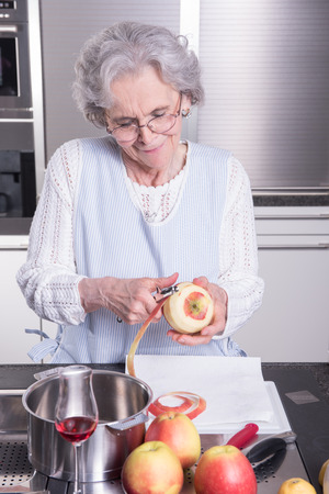 modern lifestyle: active female senior in kitchen
