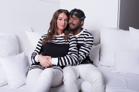 couple on couch: couple in love sitting on couch Stock Photo
