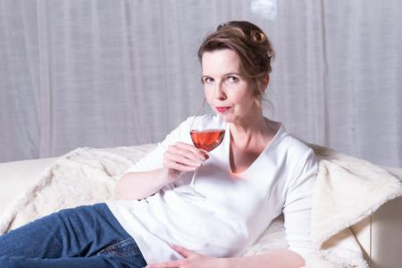 looking into camera: Portrait attractive woman looking into camera, drinking Stock Photo