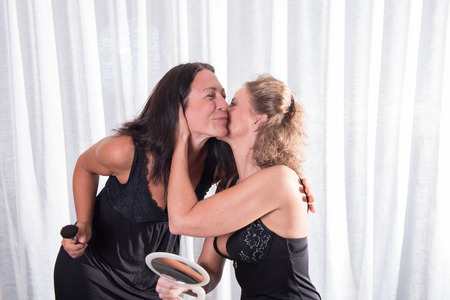 women kissing: two attractive women kissing Stock Photo