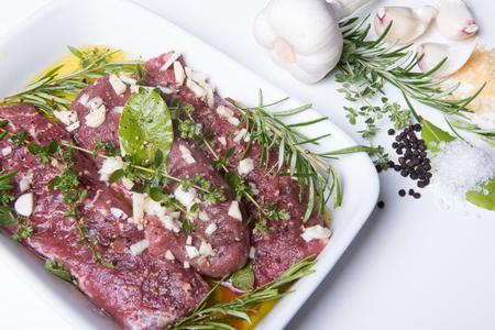 mediteranean: raw lamb fillets with mediteranean herbs