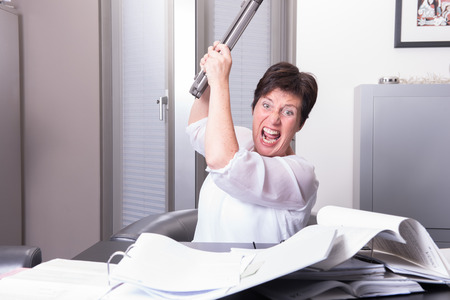 phonecall: woman is destroying her PC - overworked Stock Photo