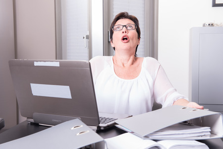 homeoffice: woman in her homeoffice has stressy moment