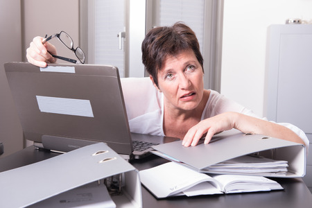 homeoffice: woman in her homeoffice is completely overworked