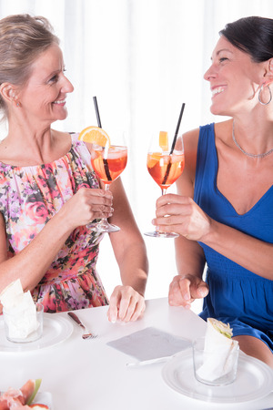 two attractive women having a light dinner