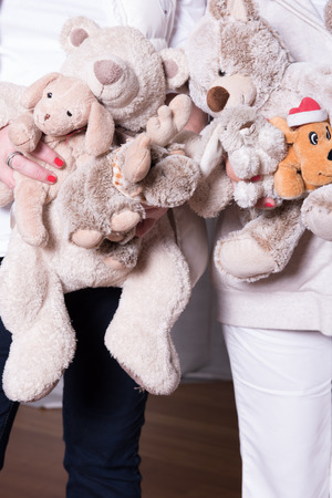 helpers: female helpers offer toys to refugee children
