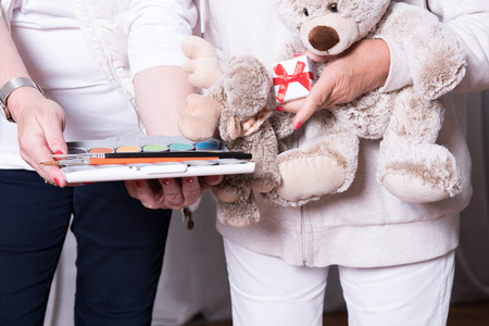 refugee: female helpers offer toys to refugee children