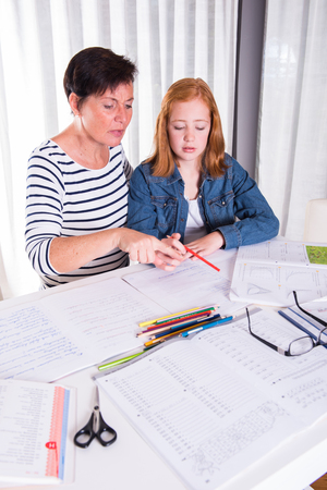 bulge: daughter talks with mother about homework Stock Photo