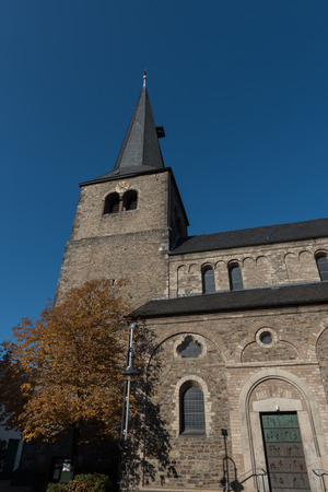 protestant: protestant church with tower in Hilden before blue sky