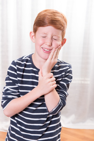 tooth ache: Portriat small boy having tooth ache