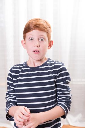 eyes wide open: Portrait small boy scared with eyes wide open