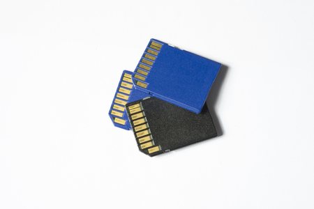 sd: three sd chips isolated in white - extreme close up