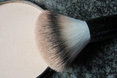make up brush: macro shot of a used make up brush on black background