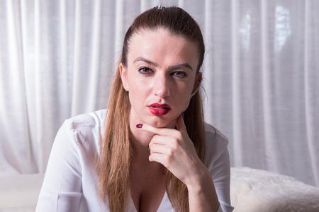 tough: Portrait of a beautiful tough looking woman