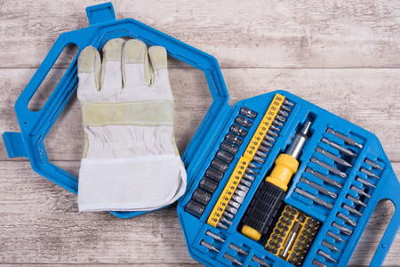 toolset: steel toolset and working glove on a wooden table Stock Photo