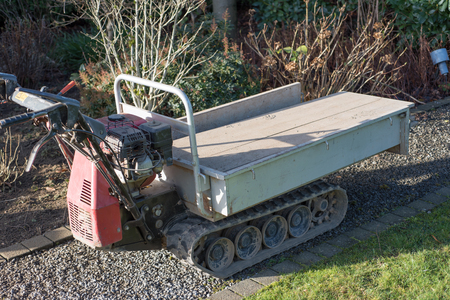 heavy duty: heavy duty transport cart with caterpillars in the garden Stock Photo