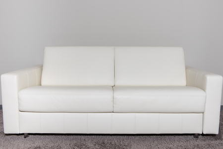 couch: beautiful white luxury couch in luxury home Stock Photo