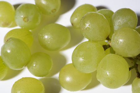 whine: close up of tasty whine grapes on white background Stock Photo