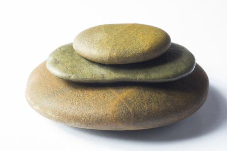 stapled: close up of Zen Stones stapled on white background