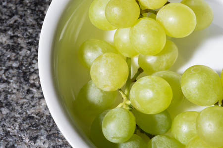 whine: close up of tasty whine grapes in white bowl Stock Photo