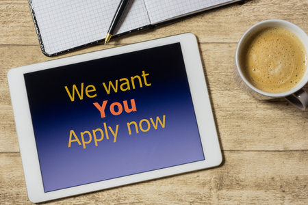 tablet with we want you - apply now on table