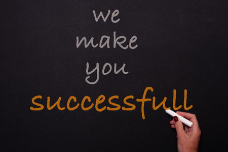 successfull: Woman writes on blackoard - we make you successfull