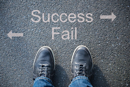 successfull: shoes on the street as symbol for success or fail Stock Photo