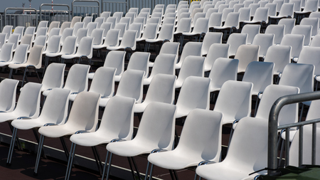 in the open air: chairs in rows in an open air theatre