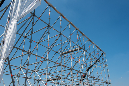 in the open air: scaffolding for open air theatre against blue sky