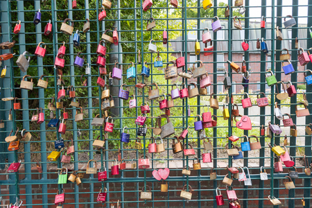 colorful love locks on the fence as concept for love Stock Photo