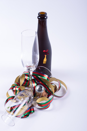sylvester card concept with bottle and glasses on white