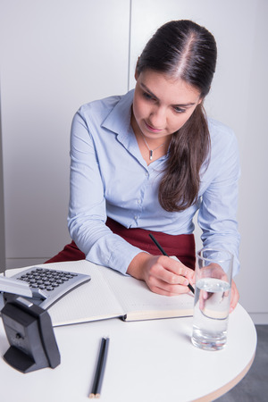 time pressure: young professional female is working under time pressure Stock Photo