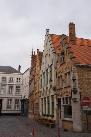 chimney corner: Street view in Brugge during autumn time