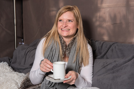 Attractive woman looking forward to her hot drink from the cup Stock Photo