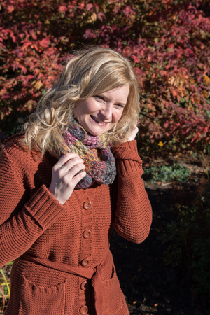red cardigan: Attractive blond woman in an autumnal park Stock Photo