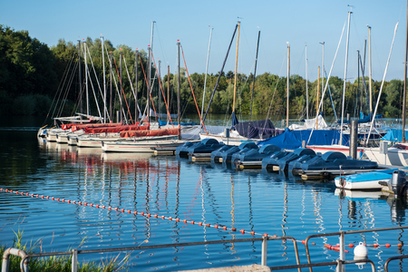 footbridges: Small harbor with sailing boats and pedal boats at the footbridge