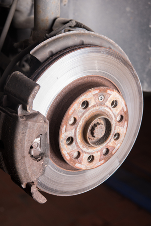Disc brake of an old car at the repair