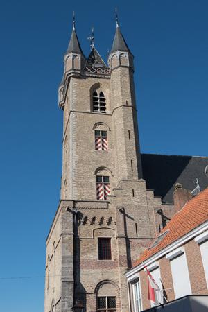 church steeple: Church in Sluis Holland in bright blue sky