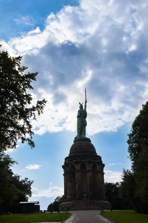 Silhouette of the Hermannsstatue in Detmold against a dramatic sky