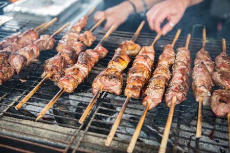 Street Food - grilled meats on skewers on the charcoal grill