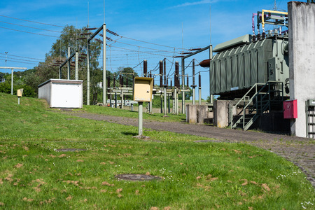 Substation in nature with electricity pylons in sunny weather