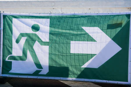 Transparent as a sign for the escape route at an event. Stock Photo