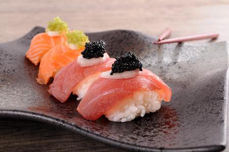 Tuna and salmon sushi with caviar photo