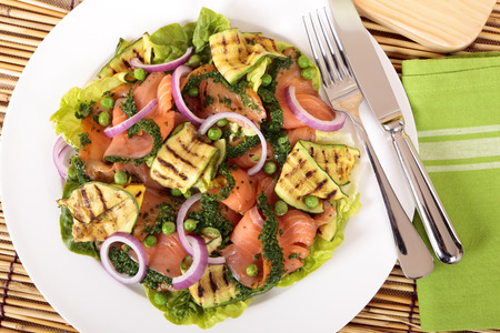 Herbed smoked salmon salad with vegetables photo