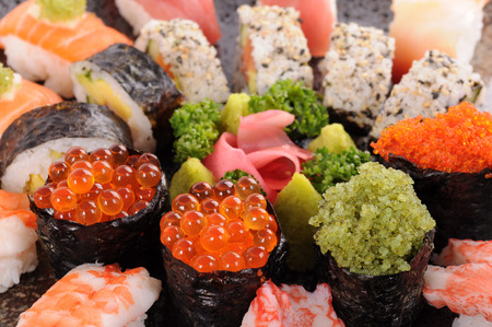 Salmon eggs with assorted sushi platter photo