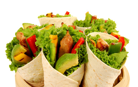 corn tortilla: Chicken and avocado wrap sandwiches on isolated white background Stock Photo
