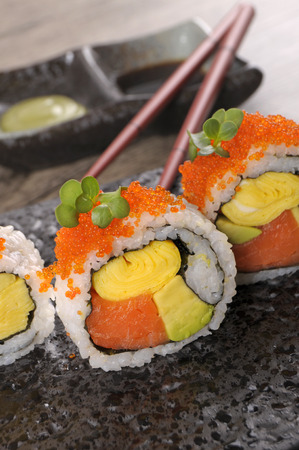 california roll: California roll sushi with caviar on a black plate Stock Photo