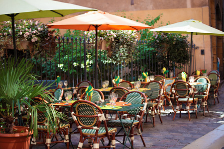 Typical French restaurant scene of tables and chairs