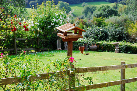 wold: Birdhouse with flowers of pastoral garden in Cotswolds, England