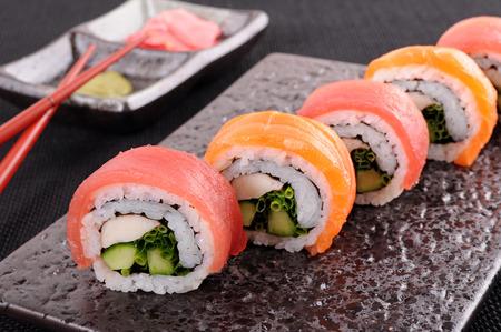 maki sushi: Salmon & tuna sushi roll on a plate